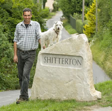 Eddie and the new Shitterton stone sign. Picture courtesy of Phil Yeomans