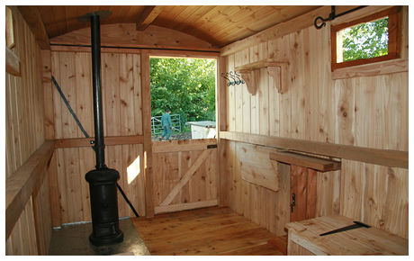 New Interior of Shepherd's Hut with renovated stove
